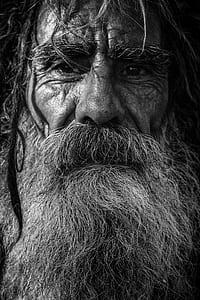 grayscale photo of man wit beard