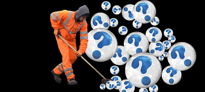 man wearing orange suit mopping question mark bobbles