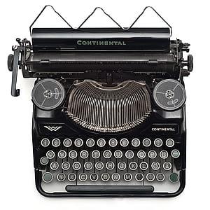 Black Continental Typewriter on White Surface