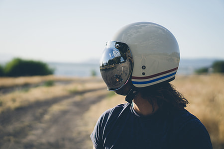 person wearing white, red, and blues tripe half-face helmet during daytime