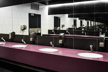 four white ceramic sinks