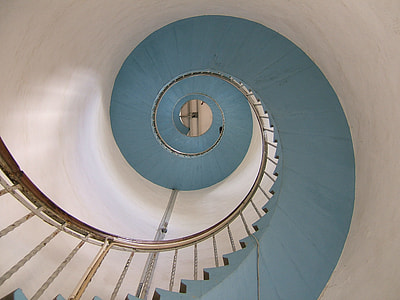 low angle photography of spiral stairway