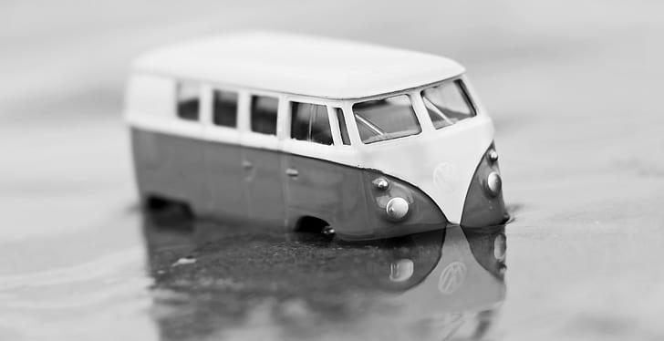 grayscale photography of Volkswagen Kombi die-cast model