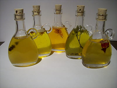 photo of five olive oil bottles