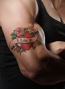 man's forearm with i Love U tattoo