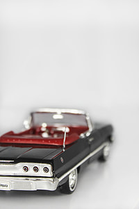 shallow focus photography of black convertible die-cast model