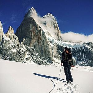 man in black coat on alps mountain