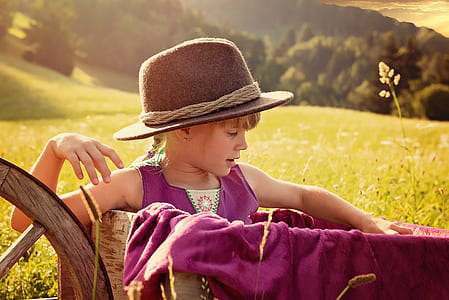 girl sitting on wagon