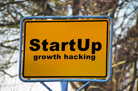 black and yellow start up growth hacking signage