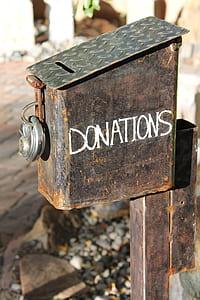 brown metal donations box