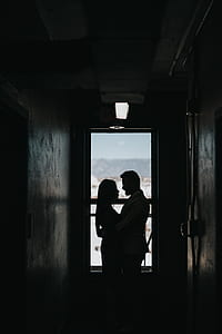 silhouette photography of couple hugging