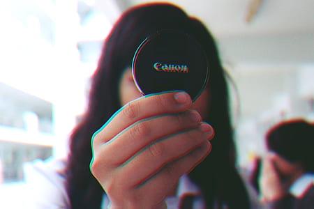 Girl Holding Black Canon Cover