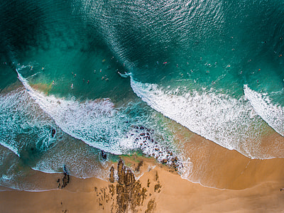 aerial shot of green and white body of water