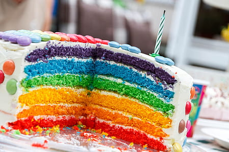 rainbow cake with white icing