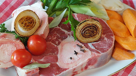 raw meat with vegetables on plate