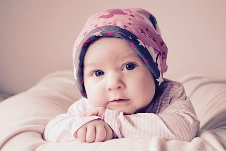baby on white textile