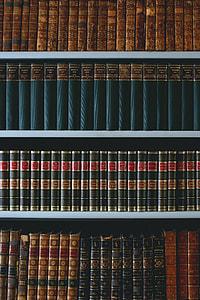 several row of organized books in bookshelf