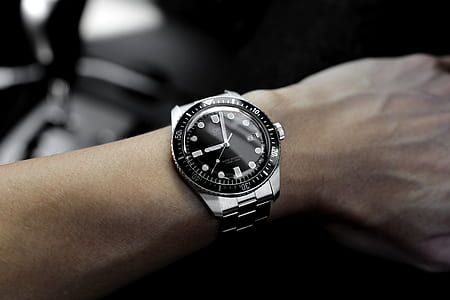round black and silver-colored analog watch with link straps at 9:02
