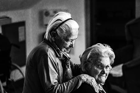 two old woman grayscale photography