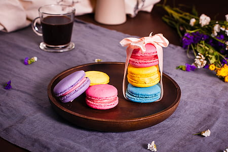 six macaroons served on plate