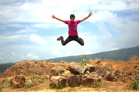 jump shot of man wearing purple shirt