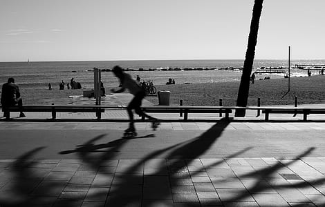 Person Skating on Road in Grayscale Photography