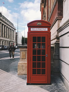photography of red telephone booth