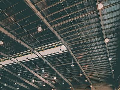 pendant lamps hanging on steel truss