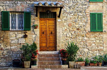 brown concrete house with brown wooden door