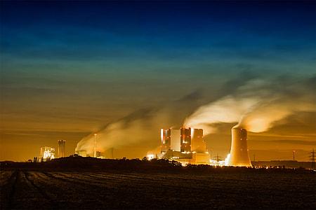 gray power plant under blue sky