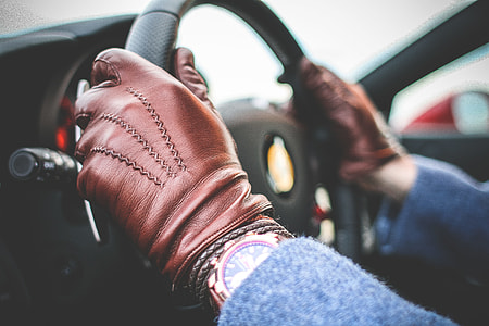 Driver with Brown Leather Driving Gloves