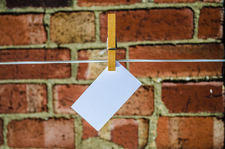 clothes pin holding white paper