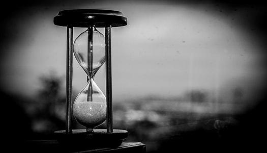 hourglass grayscale photo