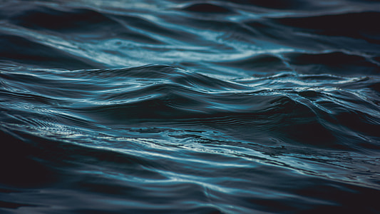 shallow focus photography of body of water waves