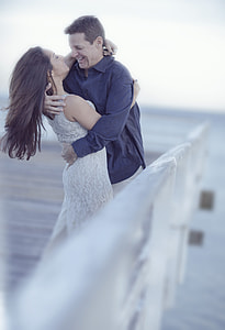 woman and man hugging each other during daytime