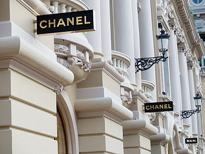 white concrete building with Chanel signage