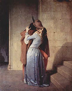 man and woman kissing beside staircase painting