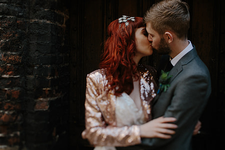 selective focus photography of couple kissing