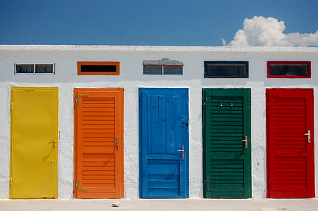 yellow, orange, blue, green, and red wooden doors