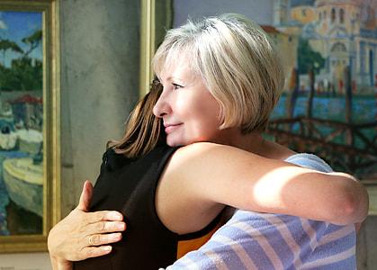 woman hugging child inside room