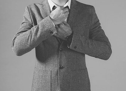 person wearing notched lapel suit jacket