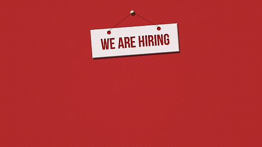we are hiring wall plaque on red wall