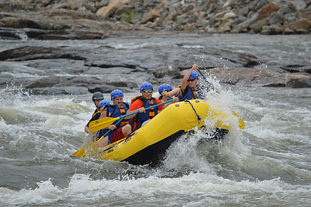 group of people rafting on river
