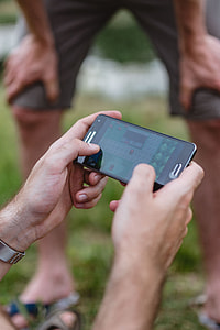 Closeup of man hands playing videogames on cell phone