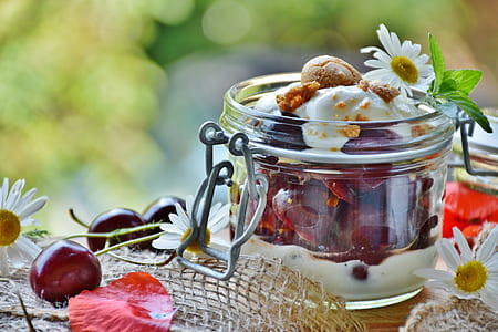 ice cream dessert with grapes on clear glass clip on mason jar