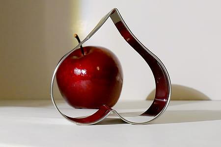 stainless steel heart frame near apple decor