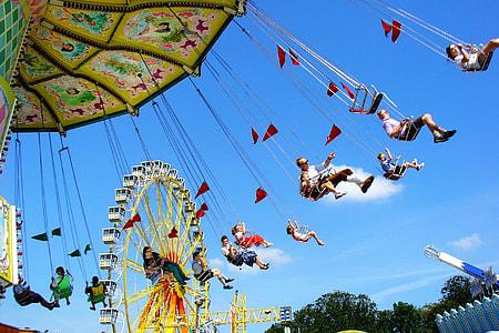 people on amusement park under blue calm sky