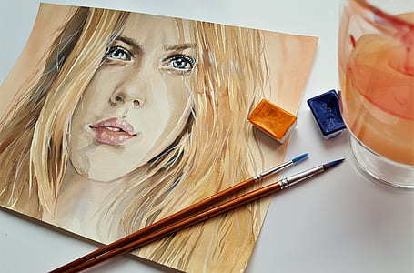 blonde haired woman painting