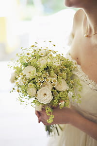 woman holding white rose bouquet