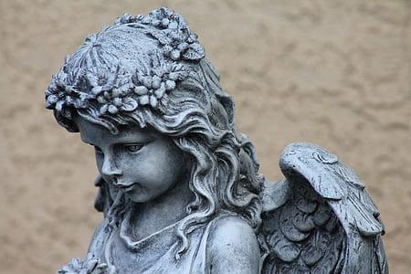 grey cherub statue